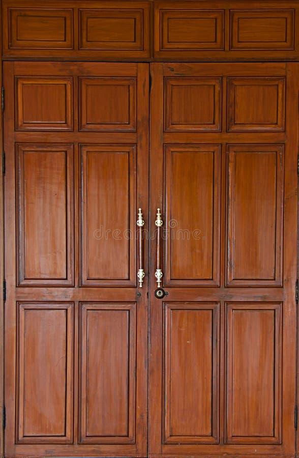 Porta da madeira do Teak fotografia de stock