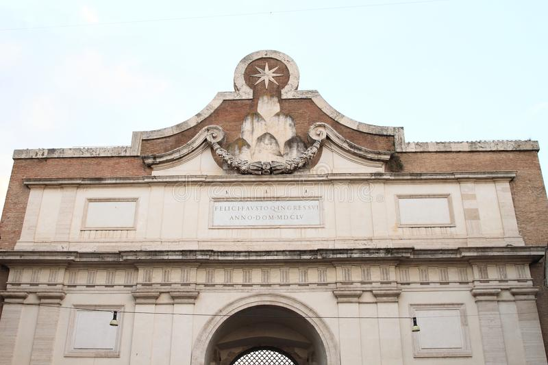 Porta del Popolo. On Piazza Flaminio with star on top in Rome, Italy stock photos