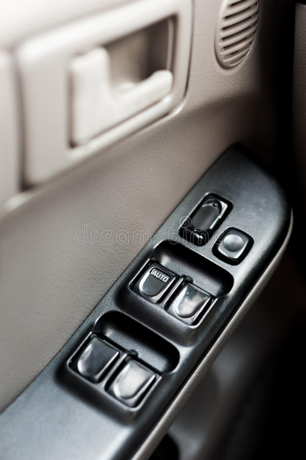 Porta di automobile con il pannello di controllo della finestra fotografia stock libera da diritti