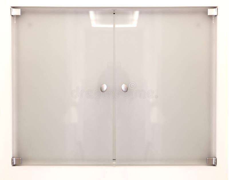 Porta do vidro geado ou do plexiglás isolada no branco foto de stock