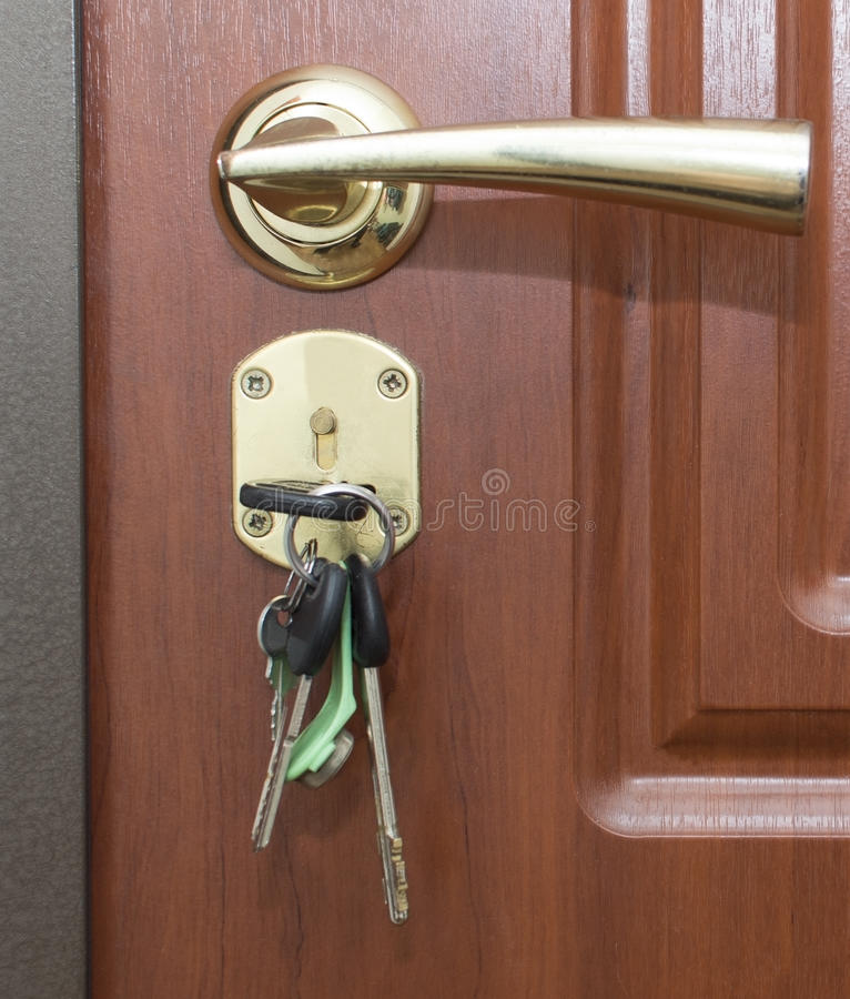Porta e chaves imagens de stock
