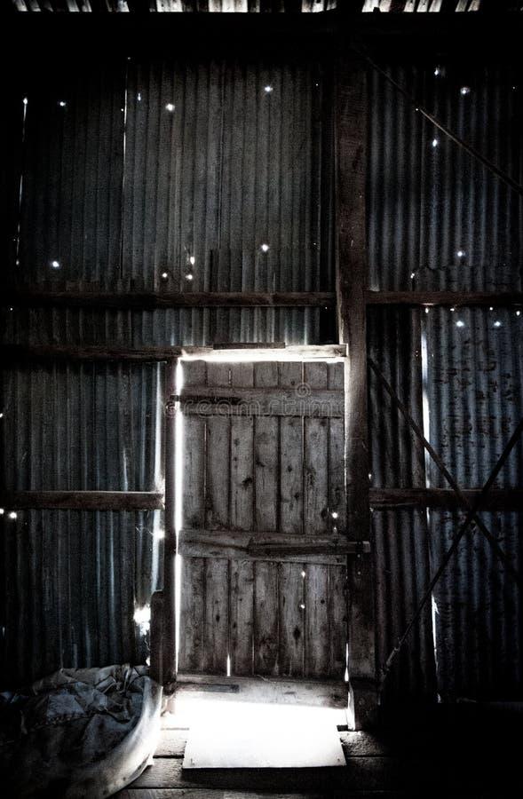 Porta lateral à vertente de corte do interior foto de stock