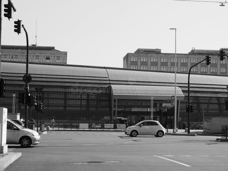 Porta Susa station in Turin in black and white. TURIN, ITALY - CIRCA FEBRUARY 2019: Torino Porta Susa railway station in black and white stock images
