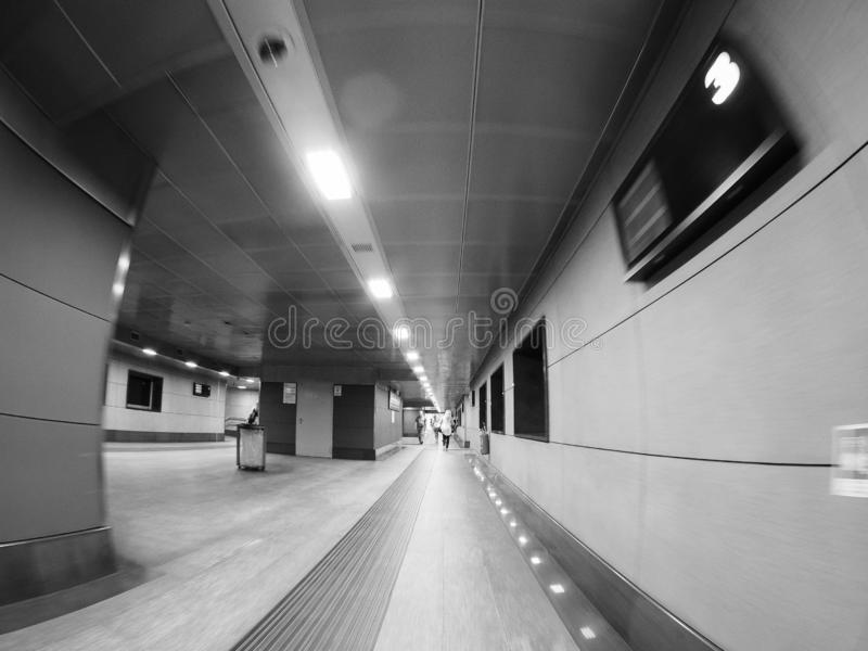 Porta Susa station in Turin in black and white. TURIN, ITALY - CIRCA SEPTEMBER 2018: Torino Porta Susa railway station seen through fisheye lens in black and stock photography