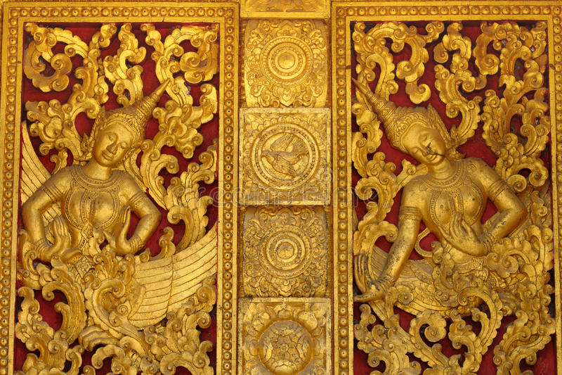 Porta tradicional do estilo de Laos da igreja budista imagem de stock royalty free