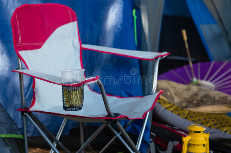 Portable chair with a glass of beer. In the park stock photos
