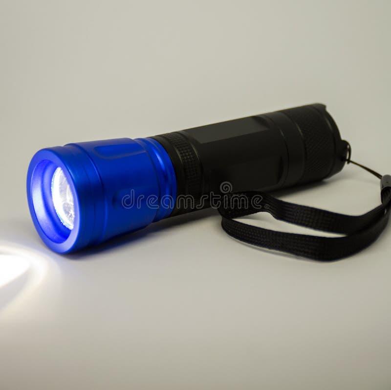 Portable flashlight or torchlight stock photo