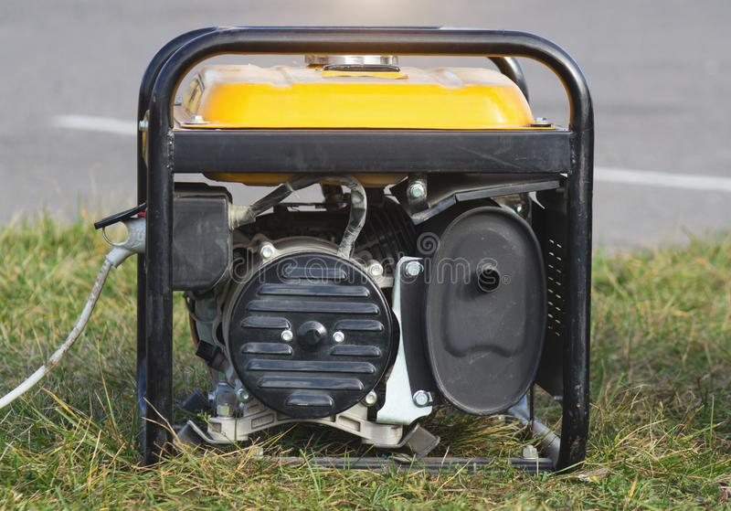 Portable gasoline generator, close-up, alternator, electricity, equipment. Portable gasoline generator, close-up transportable stock image
