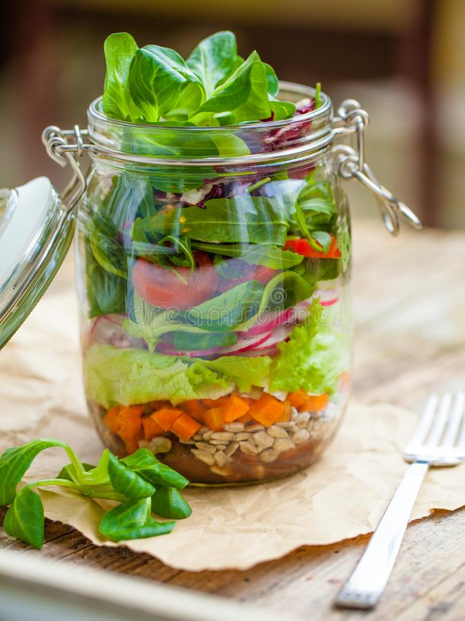 Salad in mason jar. Portable layered salad in glass mason jar royalty free stock photos