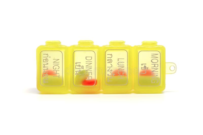 Portable medicine daily storage pill. With 4 separate compartments for morning, lunch, dinner and night on white background stock photos