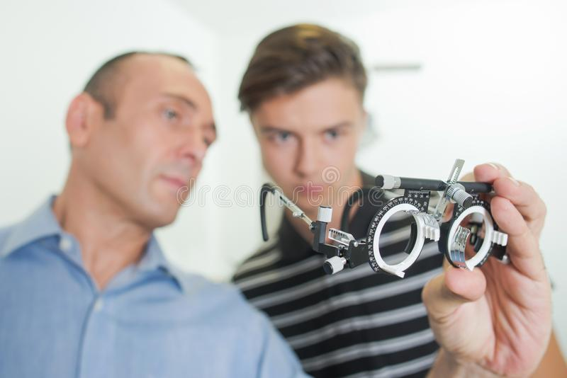 Portable phoropter and patient. A portable phoropter and patient stock images