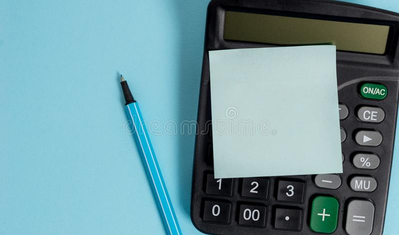Portable plastic electronic calculator device accounting marker blank sticky note colored background Empty text. Electronic calculator device blank sticky note stock images