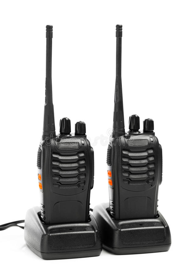 Portable radios Walkie-talkie on charging stations. Isolated on white stock photo