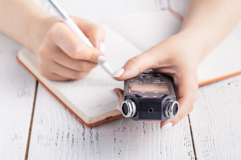 Portable sound recorder on notebook with pen. memo and planning concept royalty free stock photography