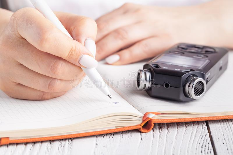 Portable sound recorder on notebook with pen. memo and planning concept royalty free stock images