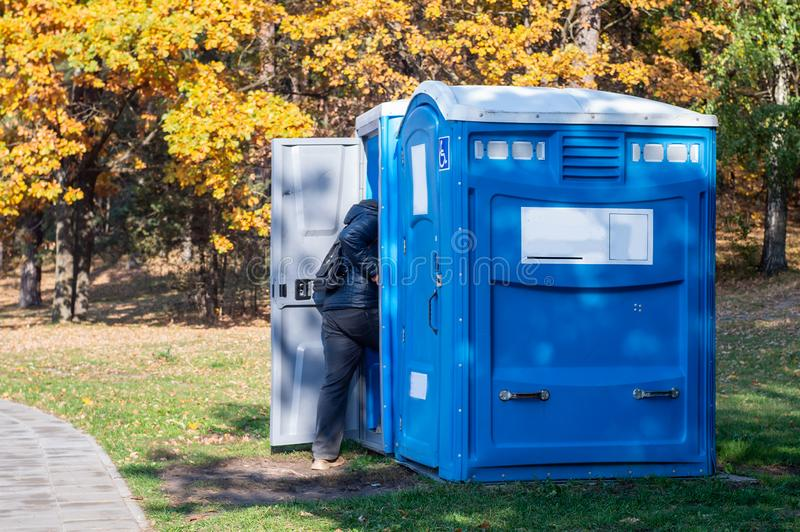 Portable toilet for the disabled. In a park stock photography