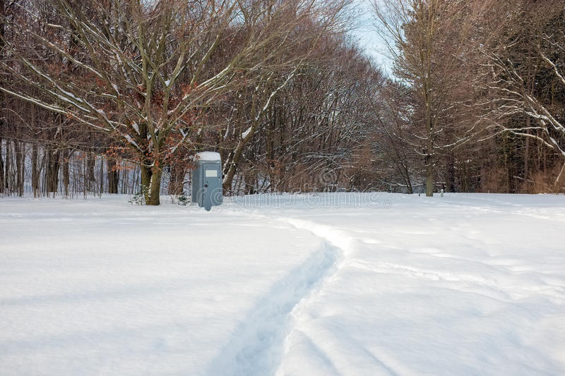 Portable toilet in the woods stock image