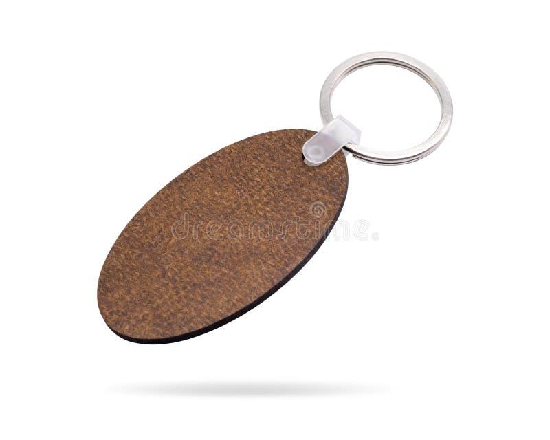 Portachiavi a anello di legno isolati su fondo bianco Catena chiave per la vostra progettazione Oggetto dei percorsi di ritaglio  fotografie stock libere da diritti