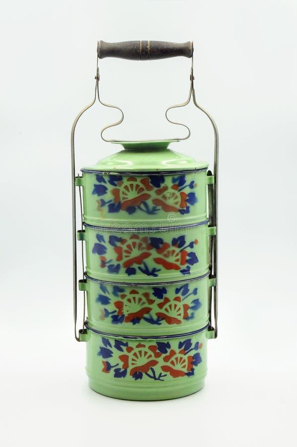 Portador verde de Tiffin del esmalte con el estampado de plores imágenes de archivo libres de regalías