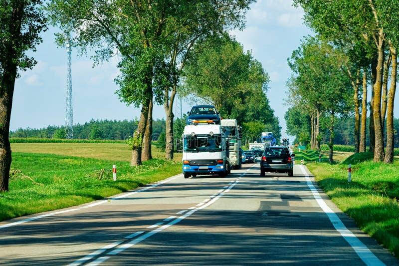 Portadores de coches en el camino en Polonia fotos de archivo libres de regalías