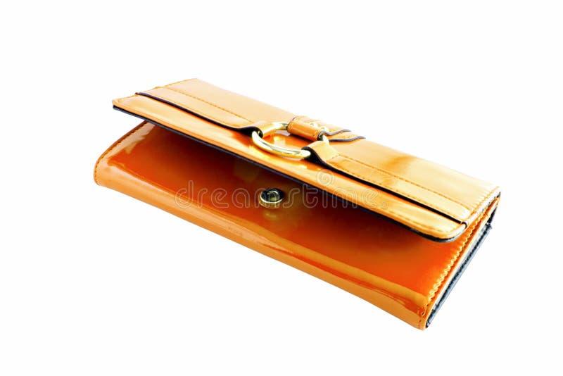 Portafoglio arancio della donna fotografie stock