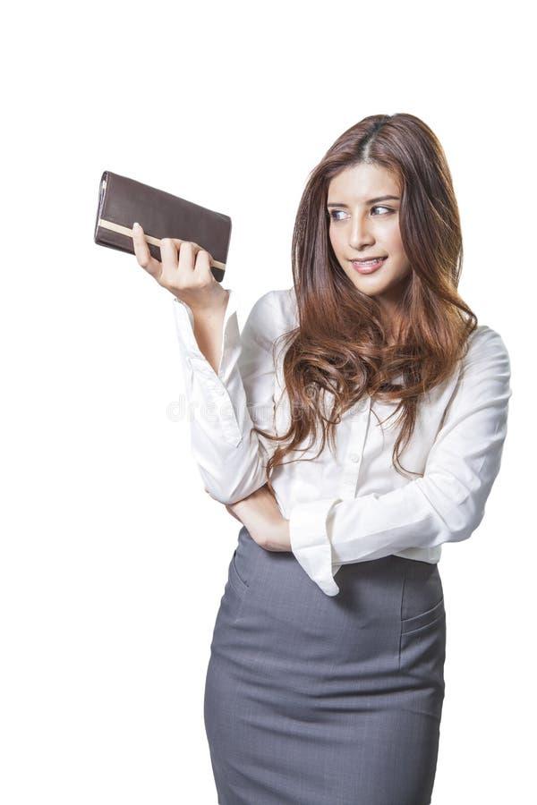 Portafoglio castana della borsa della donna del yound fotografia stock libera da diritti