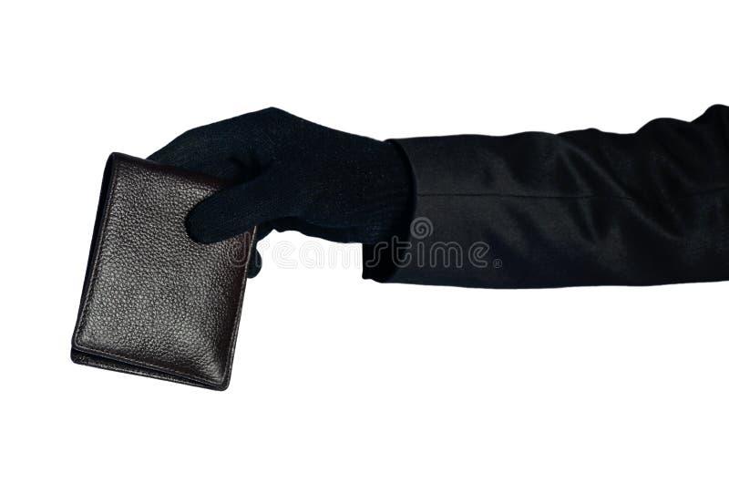 Portafoglio della gru a benna della mano del ladro fotografia stock libera da diritti