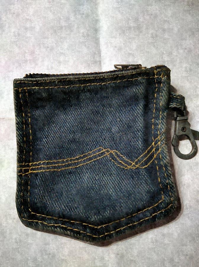 Portafoglio fatto da una vecchia tasca del tralicco immagine stock libera da diritti