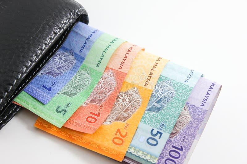 Portafoglio nero con le banconote di ringgit della Malesia immagine stock