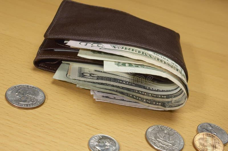 Risultati immagini per portafoglio pienodi dollari