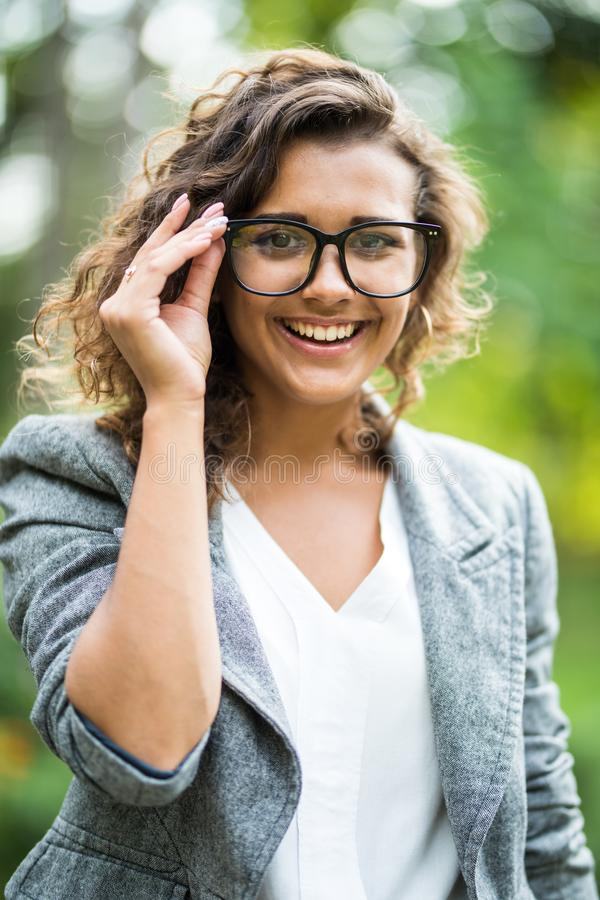 Portait of business woman in eyesglasses walking outdoor stock photography