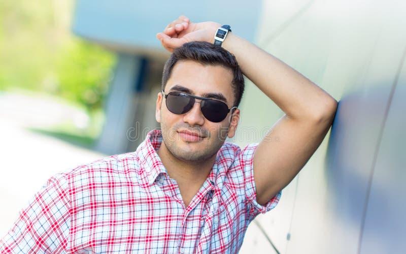 Portait of gorgeous turkish man. Arab gorgeous man wearing sunglasses, Close up shot of a guy, outdoor stock photos