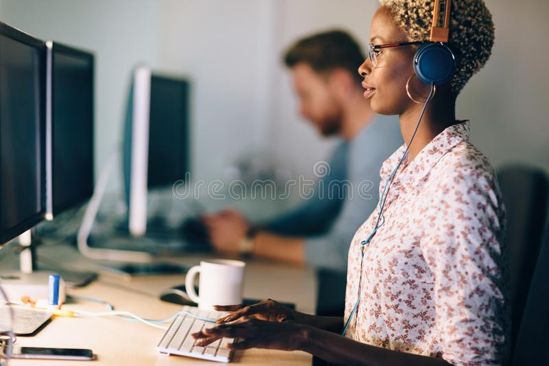 Portait of software designer working in office royalty free stock photography