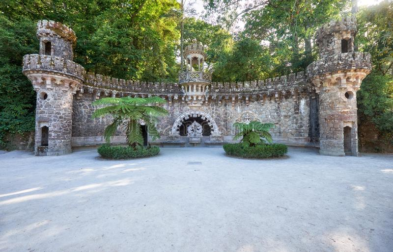 Portal of the Guardians in Quinta da Regaleira estate. Sintra. P. Portal of the Guardians consisting of two towers flanking a central pavilion under which is royalty free stock photos