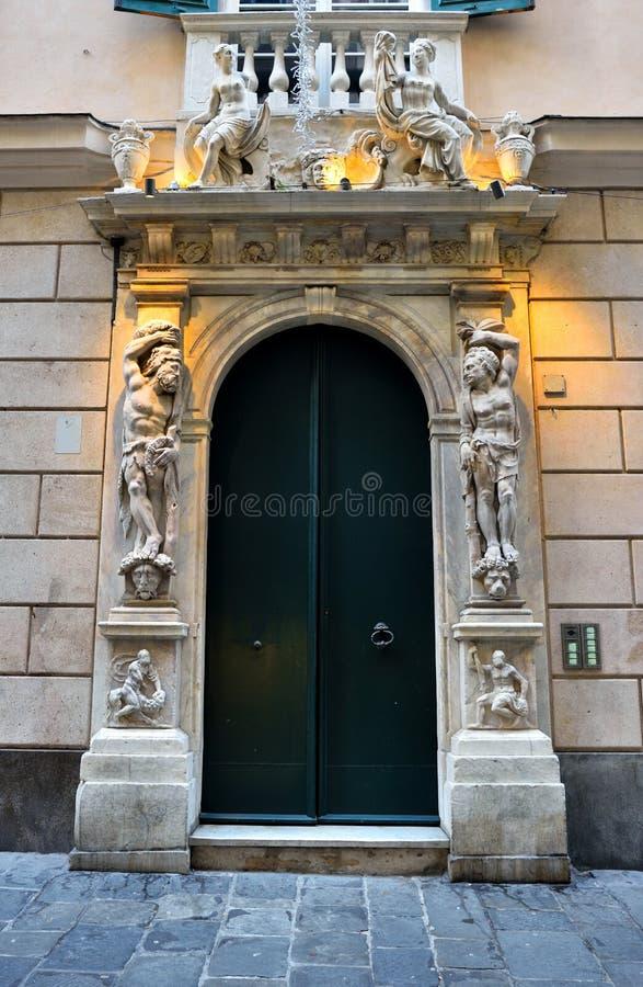 Genoa liguria italy. Portal of a historic building in via san Lorenzo Genoa Italy royalty free stock photography