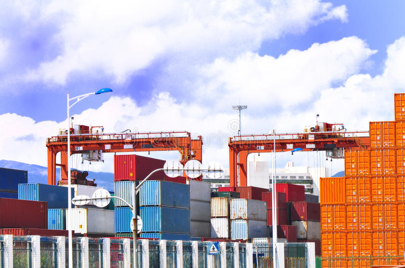 Portal jib crane and cargo containers. Portal jib cranes and freight cargo containers in yantian port royalty free stock image