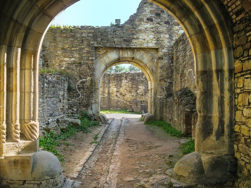 Portal in Romanesque style, corridor between stone walls. This portal is located in the fortress of Suceava, Romania stock photos
