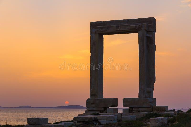 Portara in Chora town, Naxos island, Cyclades, Aegean, Greece. Portara in Chora town during sunset, Naxos island, Cyclades, Aegean, Greece royalty free stock photos