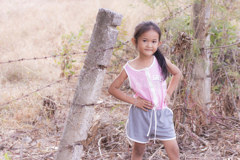 Portarit Thai little girl with barbed fence stock photography