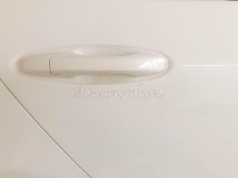 Portas de carro e abridor branco da porta de carro foto de stock