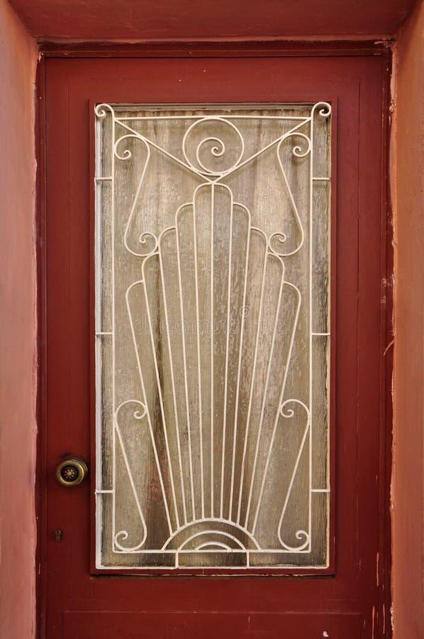 Porte avec le modèle abstrait du soleil photographie stock