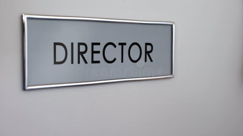 Porte de bureau de directeur, chef de société commerciale, accomplissement de but, chef fort images libres de droits