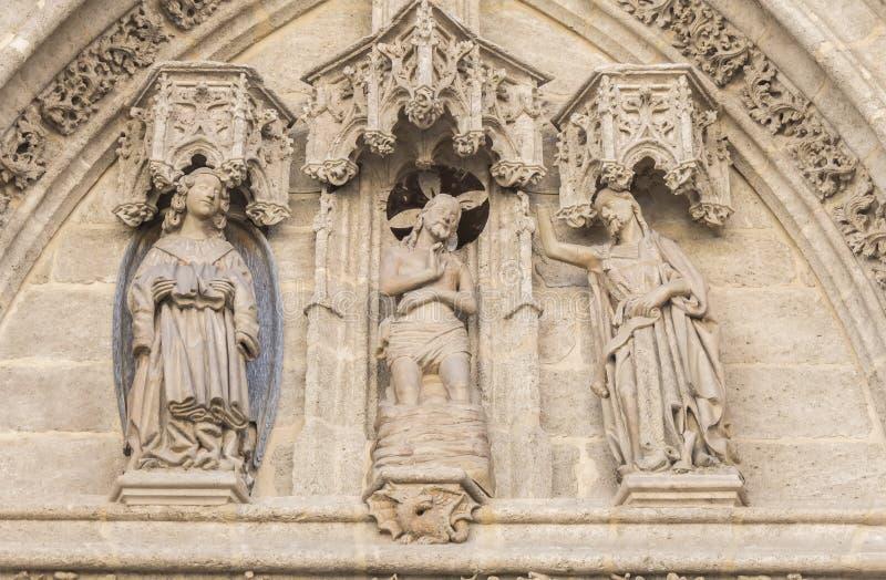 Porte de naissance ou porte de San Miguel de la cathédrale de Séville, PS images stock