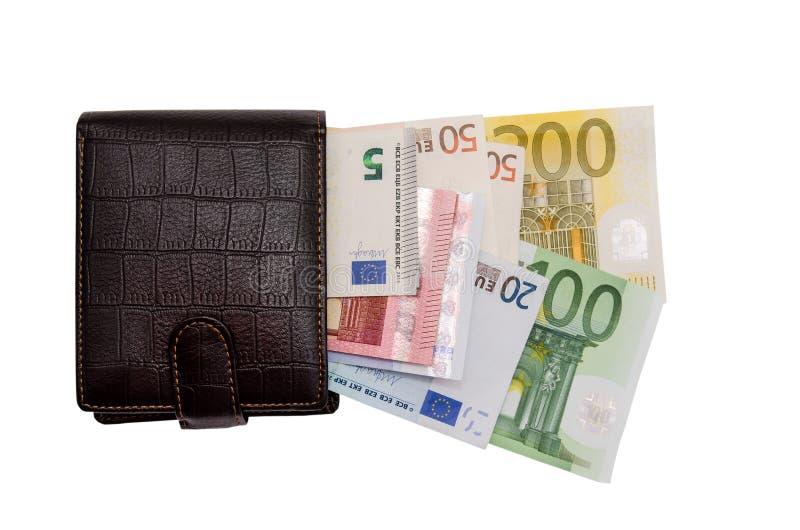 Portefeuille en cuir avec des dollars photographie stock libre de droits