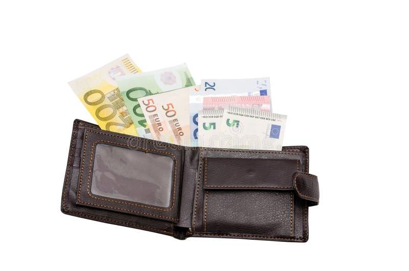Portefeuille en cuir avec des dollars photos stock