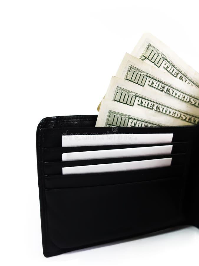 Portefeuille en cuir noir avec des dollars photo libre de droits