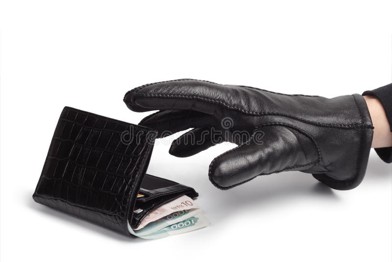 Portefeuille en hand van een dief. royalty-vrije stock afbeeldingen