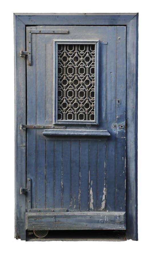 Portello di legno impolverato verniciato in azzurro con ferro saldato fotografie stock libere da diritti