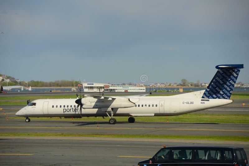 Porter Airlines Dash-8 at Boston Airport. Porter Airlines Dash-8-400 (Q400) taxiing at Boston Logan International Airport, Boston, Massachusetts, USA stock images