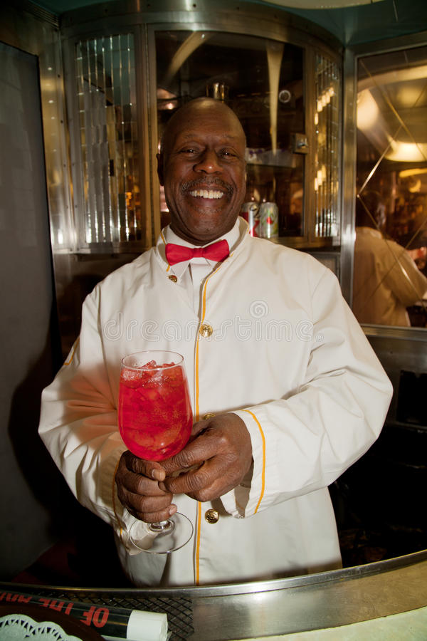 Porter on the Troop Train. African American Porter reenactor pours cherry soda on Pearl Harbor Day Troop train reenactment from Los Angeles Union Station to San stock images